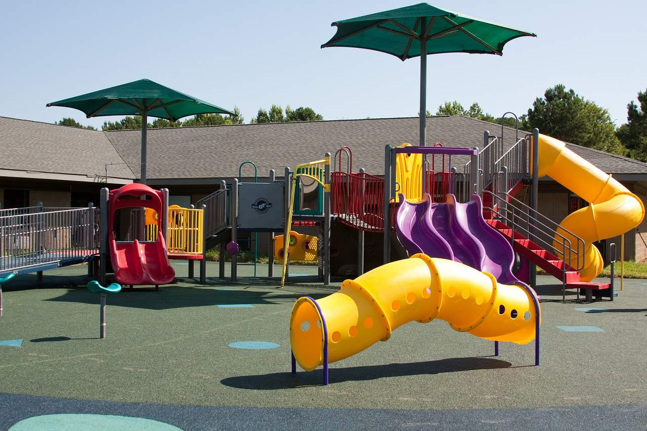 School Playground Equipment: Slides, Swings, & Markings
