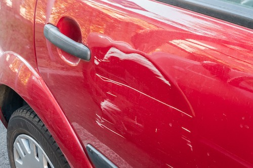 does insurance cover door dings