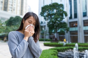 allergy woman blowing nose